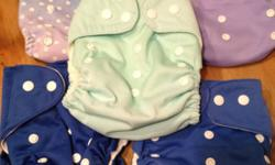 Five cloth pocket diapers. Snap closure and sizing. Includes five microfiber inserts. One is sun faded but still soft and cute. Text or email me. I have others for sale too. This ad was posted with the Kijiji Classifieds app.