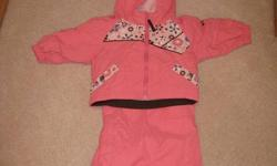 Size is 12 months.  This suit is in brand new condition.  My daughter wore it only a handful of times.  Very good quality, lighweight but very warm. Comes from a pet free & smoke free home.