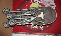 Gently used Combi Flare Stroller. Great for travelling..folds compact with carry strap. Brown/kiwi. retails new $120. $60 obo