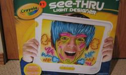 Crayola See Thru Light Designer. Animate around you. excellent shape. only used once or twice and still in original packaging. for ages 6+.