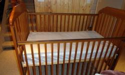For sale an oak crib and change table in excellent condition.  Includes mattress and bumper pads.