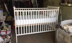 $70 - White crib and mattress in GUC for sale, smoke and pet free home. Crib has drop down side but was never used (we just turned that side to the wall), and the bottom can be moved up or down to adjust the height of the mattress. Located in MOOSE JAW,