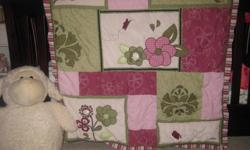 I have a 6 pcs. CoCalo bedding set for a crib in excellent condition. We paid $330.00 for it. Includes: Mobile, window valance, fitted crib sheet, bumper pads, dust ruffle, and quilt.