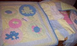 Crib bedding set  includes bed skirt, comforter and bumper pads in excellent  condition can be used for both boys/girls. Asking $25.