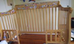 Starting as a crib, this converts into a transitional or day bed and can also be used as a full-size headboard. The picture shows the frame as a transitional bed. When used as a crib, all sides are fixed. The wood is a natural finish. The model number is