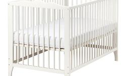 White Crib with Conversion kit, mattress and bed sheet(OBO) .