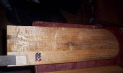 "made from island maple with walnut slide for pegs. size 19"" long x 6"" wide"