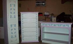 The change table is approximately 34 years old and is made from solid wood.  The dresser is 50+ years old and is also solid wood.  The shelving unit (for toys or seasonal clothes) is about 18 years old and is made from pressboard.  The colors are