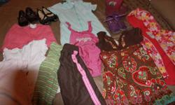 LOTS of clothes 9 pants, 1 spring coat, 1 swim cover,1 dress 1 skirt 1 bathing suit, rainboots size 8, 3 dress shoes size 8, 4 sweaters/hoodies,8 long sleeve 3 pajamas and more! summer and winter. Lots of OLd Navy, GAP, Childrens Place, and Gymboree. some