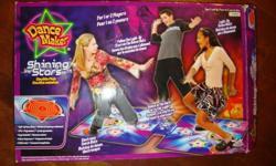 Electronic Dance Mats, still in box, never used. Dance in the dark or in the light! Light up dance mats for 1 or 2 players. Follow the light-up stars on the dance mats. Features: light-up dance mats 3 pre-programmed songs included 4 dance sequences 3