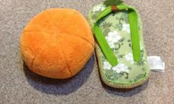"""2 decor pillows for tropical theme excellent shape. Orange ball is like the size of a large basketball and flip flop is 18""""x9"""" Take them both for $2"""
