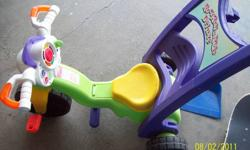 Great new shape, lights and sounds 3 in one 1 tryke Push handle, adjustable seat, handle removes once child is able to ride on own Used indoors only Start your xmas shopping early. Firm