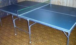 Very nice folding green games table in excellent condition. Includes net but no balls or paddles. Comes from non-smoking home. Dimensions 9 feet x 5 feet x 30 inches high. Table top is 3/4 inch thick with reinforcing metal frame. Price firm. Please call