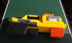 Deploy Nerf Gun; fold up gun with mag and darts.