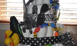 Great Baby Shower Gift!!! Are you looking for that perfect gift for a new or expectant Mother in your life? Please let me know if you need me to make you a diaper cake. Can make for any price need. Call Ashley at 403-581-3898