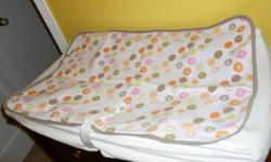 Change pad (barely used) with straps to hold the baby. Comes with a cover and 2 Kushies mats. Change pad was used for a short period of time. It attaches to or sits on most standard change tables or dressers. The Kushies mats are soft on one side and