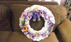 These are diaper wreaths. They are made by myself. They consist of 26 Huggies Diapers, soothers, bibs, booties, teething items, and toys. They are really cute and well made. There are eight of them. Keep in mind they are pre-made and cannot be changed. If