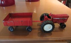 ERTL INTERNATIONAL TOY DIECAST TRACTOR AND WAGON.