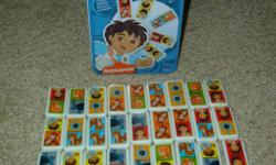 28 Piece Diego Dominoes. Glass/Ceramic pieces and complete in tin container. Excellent Condition!