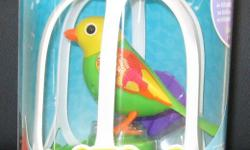 DigiBird with cage included, green in color. This is a new unused unopened item. First 24.00 takes it. Email or phone 902-439-9173