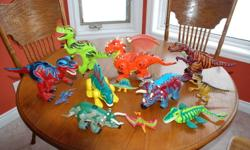 Set of dinosaurs, some walk, some 'roar, all move in some way. Batteries still working.