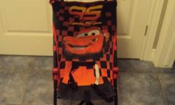 """Brand new """"Cars"""" umbrella stroller.  Used once (I forgot my stroller when I went to Niagara Falls and had to buy a stroller for the day).  Works great and has a sun shade for those hot days.  From a smoke and pet free home.  $15.00 firm.   Please check"""