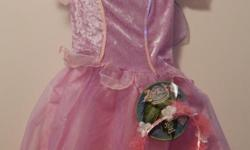 LILY Fairy Sparkling Dress (Disney). Pink and light purple with sequin edging, attached wings and separate halo. Ages 3+. Size labelled 4 - 6X Measures: chest 24 in, length 22 in Original packaging. Smoke and pet free. Cross posted. First come.
