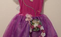 PRILLA Fairy Sparkling Dress (Disney). Pink and Purple with attached wings, separate coordinating halo and sequin trim. Ages 3+. Size labelled 4 - 6X Measures: chest 24 in, length 22 in. Original packaging. Smoke and pet free. Cross posted. First come.
