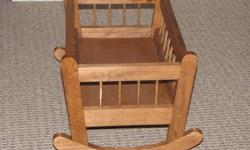 """Newly made, wooden doll cradle.  Dimensions are 12"""" x 19"""".   Perfect for a Christmas present."""