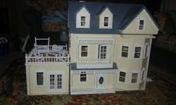 This dollhouse is in good condition with a very small amount of damage to the railing on the outside.  It retails at around 750.00. Opens from the front and has a sundeck.