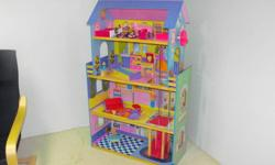 4 Story wooden doll house with elevator and 17 pieces of furniture.