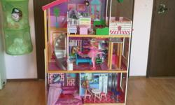 This is in New condition! ToysRus is selling for $130, but then you have to build it. This comes with additional furniture accesories and 3 dolls. Has elevator that works. A great gift idea that is complete.   We live in the west end near Callingwood.
