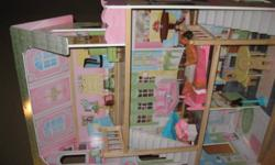 Offering a 3 storey doll house for sale. Like new condition. Stands apprx 48 inches high.