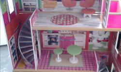 Extra large Doll house all put together. Daughter had a lot of fun with this but has since outgrown. Open to offers
