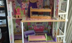 Hours of fun with this dollhouse. Three floors. Elevator. Check out the pictures.