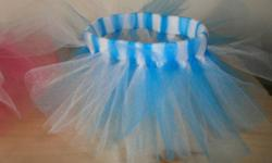 Locally made doll tutus perfect for playtime with dolls or stuffed animals. Tutus have a 9 inch waist band. Available at this time: blue/white pink/white purple/white pink/white/purple - sold blue/white/pink Also available but not shown: lime/white