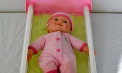 Good condition pink and while doll bed. Comes complete with baby doll to put to sleep. Small size, tucks easily under your child's bed or dresser.