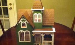"""Meticuliouly painted and decorated dollhouse, includes baby doll and furniture. Measures 19.5"""" high, 15"""" wide, by 12"""" deep. Ideal Christmas gift for that special little princess."""