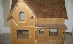 Made originally from a kit.   Plexi glass windows with design   All wooden, 2 story   Great for the collector!