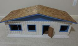 This is a homemade 4 room dollhouse. The front door opens and the front wall can be removed to access the dollhouse. It has a wood shingle roof. Our daughters are grown now and it is time to downsize.