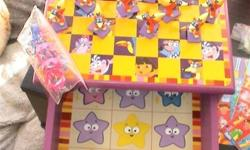 Dora Game House, includes games like: Bingo Tic Tac Toe Checkers Dominoes Memory Match Old Maid Go Fish Crazy 8's All games listed have all their pieces, Located in Salmon Arm.
