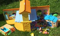 Dora Doll House and Accessories   Lots of Dolls and Furniture.  Good Condition. For Sale for $25.00.