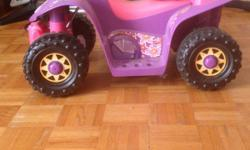 For sale is a Dora motorized 4 wheeler for kids with helmet, in great condition.