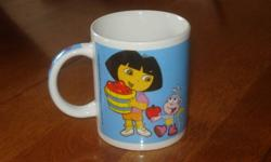 I am selling this Dora Mug. It has a picture of Dora, Boots, and Swipper on it. It is made out of glass. It is in good condition and I am selling it at best offer. **Check out my other ads**