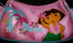 For sale is an adorable Dora Purse in a Hawaiian Beach theme, it is in excellent condition (looks brand new)   Retailed for $14.99+   Would make great Chrismas present!   Can meet or deliver in Kingston Lots of other great items listed, take a look!