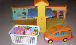 The talking doll house opens up to 2 levels and has different buttons that can be pushed to play music, make sounds or hear talking.  You can fold the house up for storage. It also comes with a basket full of furniture, dolls, etc.  The van has 4 moving