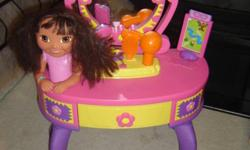 Dora talking vanity has a styling head and interactive cards.Comes with stool, curing iron, blow dryer, crimper,brush,etc all with working sounds.The drawer opens to store accessories. Asking $95 or best offer($180 NEW)