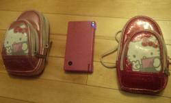 Pink Nintendo DSI Very good condition. Includes two styluses plus finger stylus, two Hello Kitty cases and many games, including Super Mario Bros, Imagine Animal Doctor, Cooking Mama 2, Zhu Zhu Pets 2, Alice in Wonderland, Petz Horses 2, High School