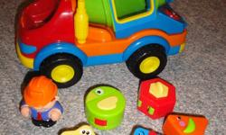 Gently used Dumptruck toy with 5 different blocks.  Dumptrick lifts, makes sounds when you press the buttons at the back.  Shapes open up into different animals, they fit into the back of dumptruck. ASKING $7.00   My prices are firm, no bartering please.