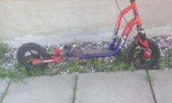 DUAL ADJUSTABLE SUSPENSION SCOOTER DYNO BRAND XTI 120S RED BLUE LIKE NEW AIR FILLED RUGGED TIRES ARE STILL IN GREAT CONDITION TIRE TREAD HARDLY WORN OUT LONG BOARD AREA DUAL SIDE PULL BRAKES GREAT SUSPENSION VERY RUGGED . Pick up only